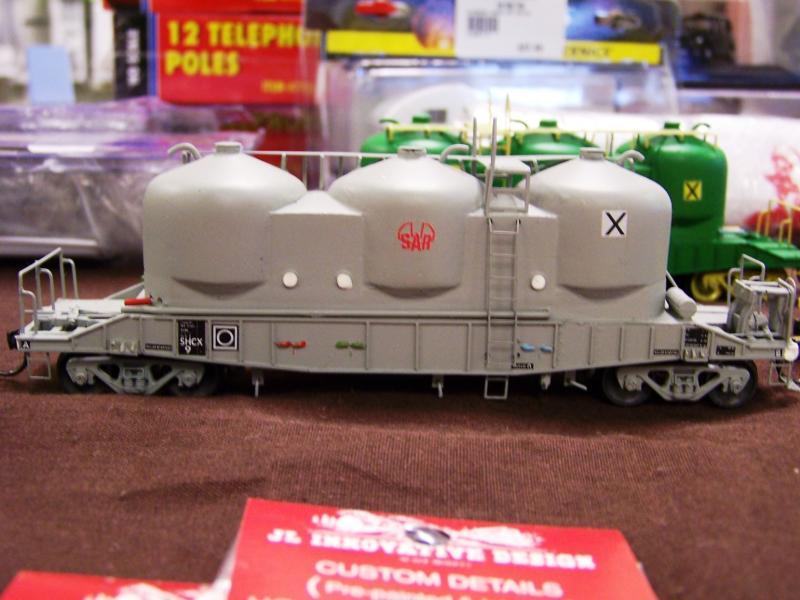 SHCX cement wagon in later SAR grey, also AN scheme behind,